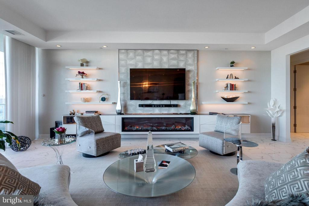 Accent wall features modern electric fireplace - 1881 N NASH ST #2309, ARLINGTON