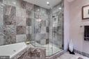 Master shower has glass enclosure w/bench - 1881 N NASH ST #2309, ARLINGTON