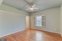 secondary bedroom with hardwood floors - 17066 WINNING COLORS PL, LEESBURG