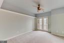 secondary bedroom with balcony - 17066 WINNING COLORS PL, LEESBURG