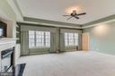 master bedroom with fireplace and beautiful views - 17066 WINNING COLORS PL, LEESBURG