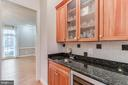 wet bar with wine refrigerator - 17066 WINNING COLORS PL, LEESBURG