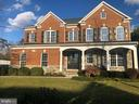 Gorgeous brick front home with slate patio - 25638 ELK LICK RD, CHANTILLY