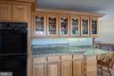Glass cabinets throughout kitchen - 43260 PRESTON CT, ASHBURN