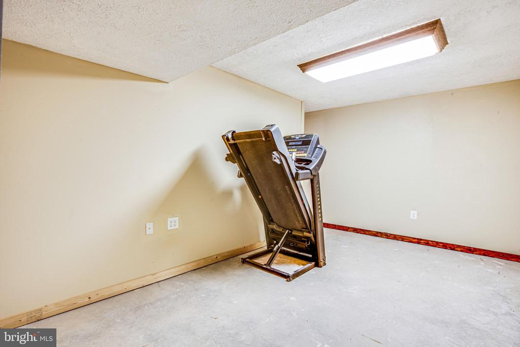 UNFINISHED LOWER LEVEL EXERCISE ROOM - 7311 MIDDLETON DR, FREDERICKSBURG