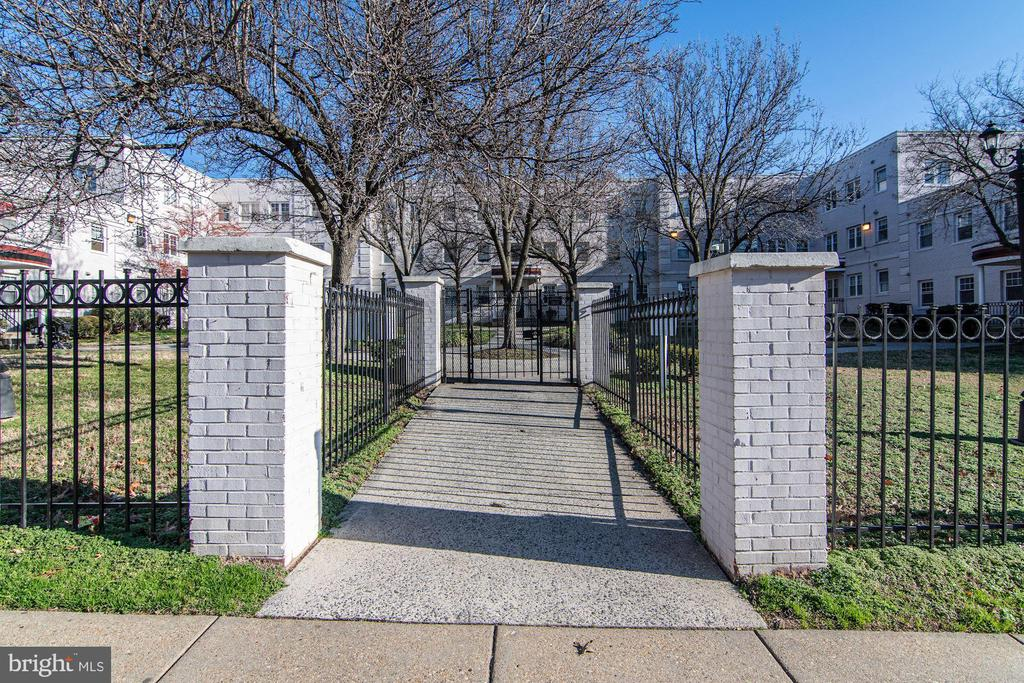 From sidewalk, into gates of gated condominiums - 3874 9TH ST SE #102, WASHINGTON