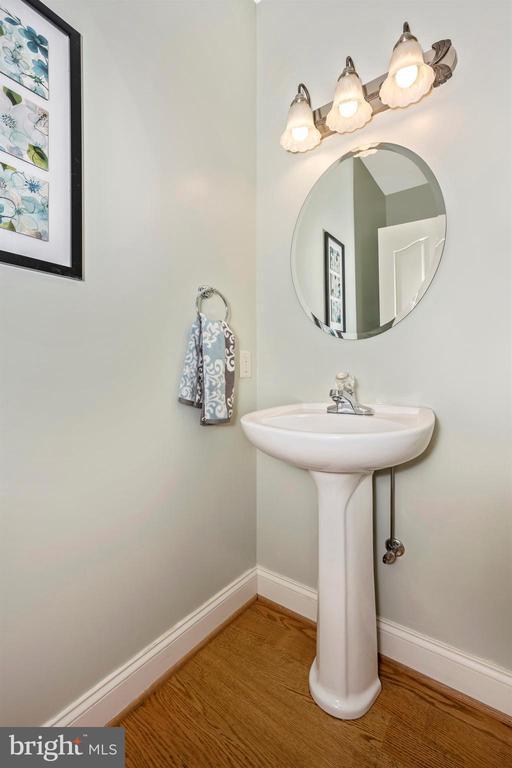 Main level powder room - hardwood floors - 10616 BRATTON CT, WILLIAMSPORT