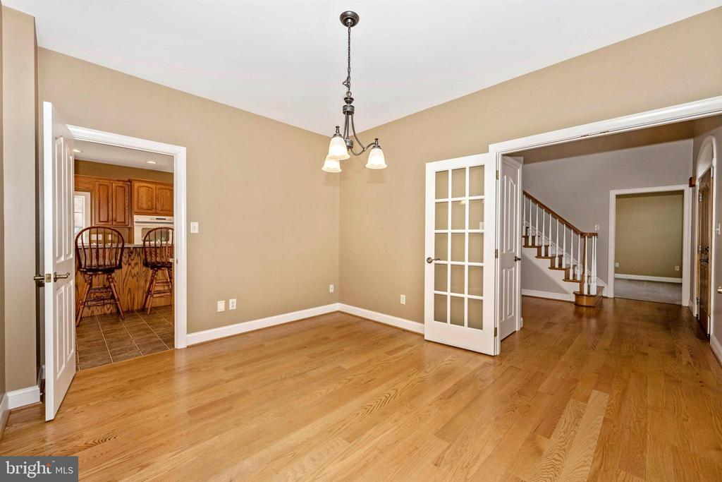 Awesome hardwood floors in dining room - 10616 BRATTON CT, WILLIAMSPORT