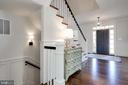 wainscoting and sconces in stair to LL - 3465 N EMERSON ST, ARLINGTON