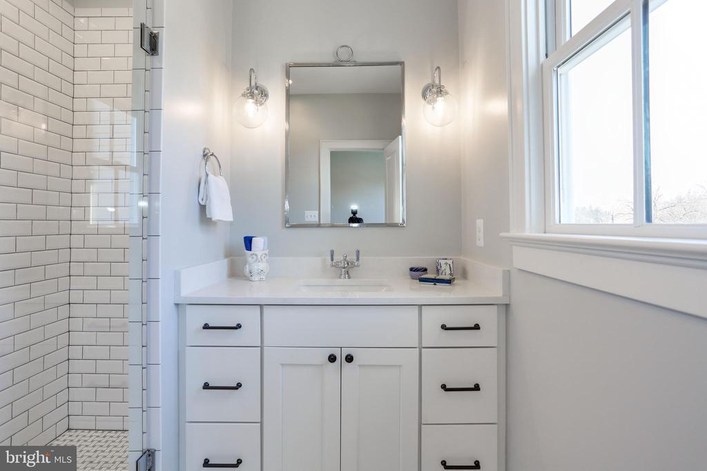 marble topped vanity, sconces at mirror - 3465 N EMERSON ST, ARLINGTON