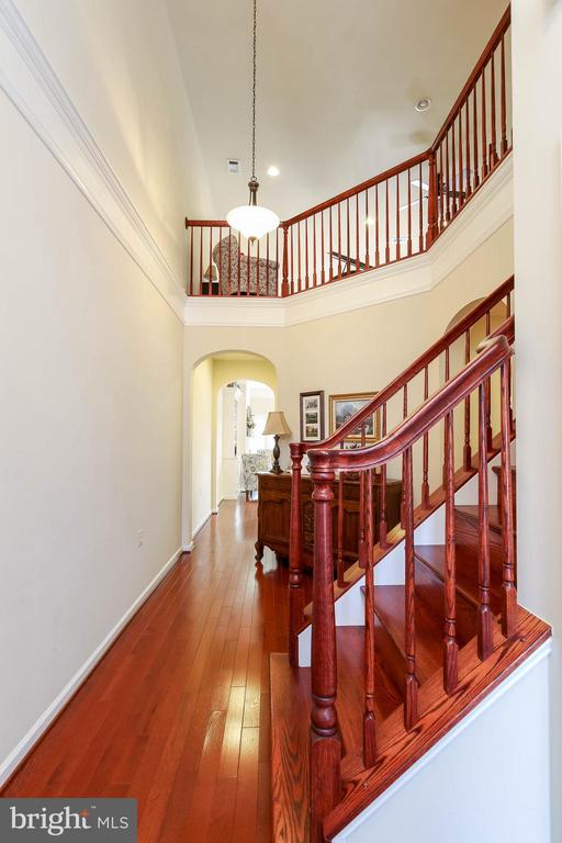 2 STORY FOYER WITH HARDWOOD FLOORS AND STAIRS - 2302 ROE LN, FREDERICK