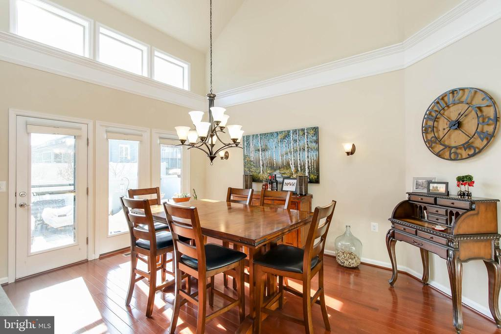 DINING ROOM WITH DOORS THAT LEAD TO PAVED PATIO - 2302 ROE LN, FREDERICK