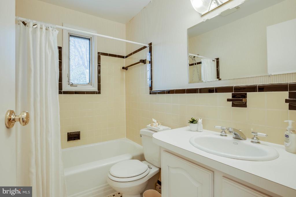 Main level ceramic tile full bath - 12602 VALLEYWOOD DR, SILVER SPRING