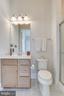 En-suite bathroom w/shower off of main level BR - 1061 MARMION DR, HERNDON