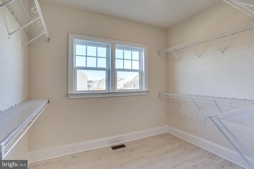 Plenty of light in master bedroom closet - 1061 MARMION DR, HERNDON