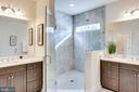 His + hers vanities w/spa shower - 1061 MARMION DR, HERNDON