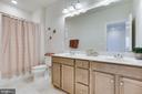 Hallway bathroom w/double vanity + tub - 1061 MARMION DR, HERNDON