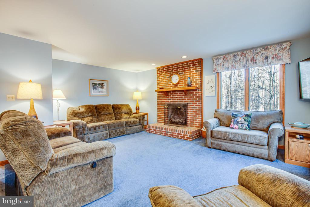 Living Room with Brick Hearth Fireplace - 7400 BROWNS FARM RD, SPOTSYLVANIA