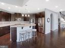 Upgraded kitchen with granite and double oven - 2952 MILL ISLAND PKWY, FREDERICK