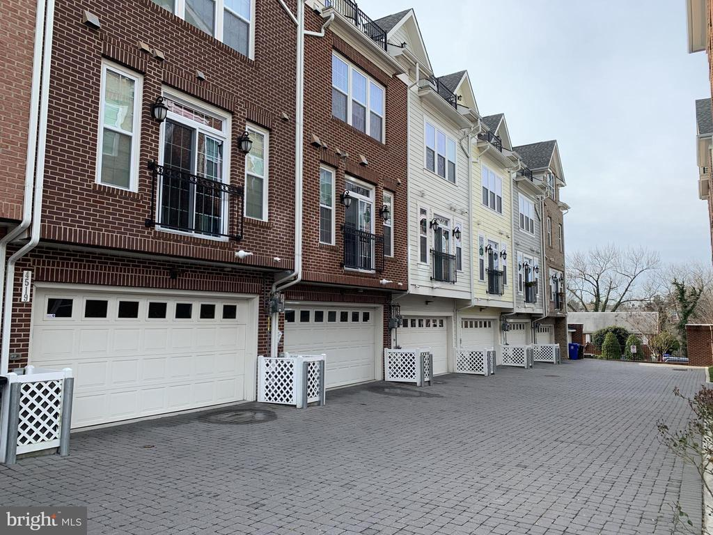 Complete with/a two car garage and roof top deck. - 4523 WILSON BLVD, ARLINGTON