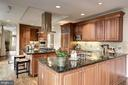 Kitchen with terrace access - 7405 ARLINGTON RD #402, BETHESDA