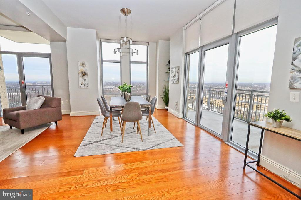 Dining area abuts a balcony with outdoor seating - 11990 MARKET ST #1914, RESTON