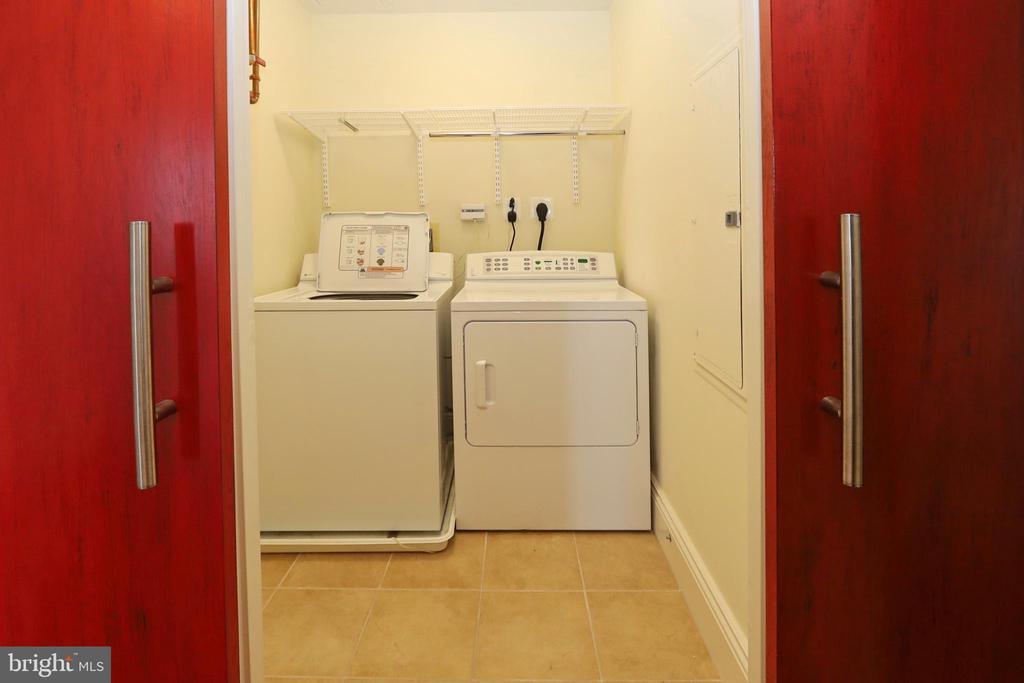 Custom barn doors access the laundry - 11990 MARKET ST #1914, RESTON
