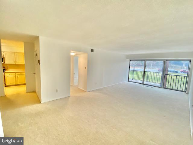 Living Room with Entry to Dining & Kitchen - 1300 ARMY NAVY DR #105, ARLINGTON