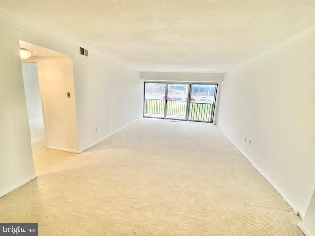 Living Room with Balcony - 1300 ARMY NAVY DR #105, ARLINGTON