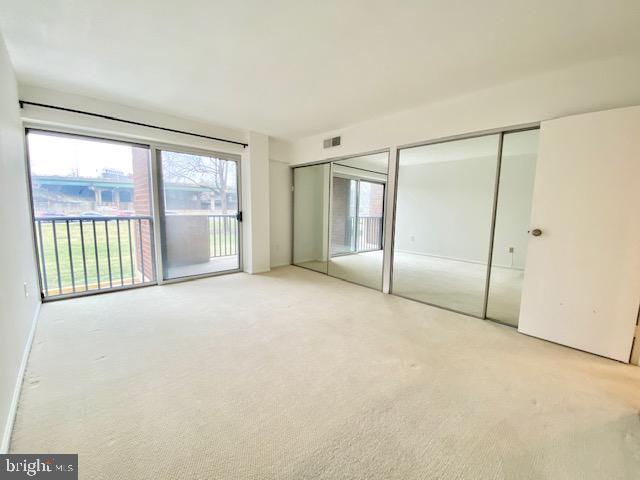 Bedroom with double mirror closets - 1300 ARMY NAVY DR #105, ARLINGTON