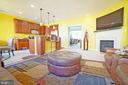 Open kitchen and living space with gas fireplace - 647 WHETSTONE GLEN ST, GAITHERSBURG