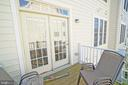 Sunny rear porch - 647 WHETSTONE GLEN ST, GAITHERSBURG