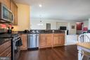 Kitchen w/ Granite, Stainless Apps & Maple Cabs - 20570 HOPE SPRING TER #401, ASHBURN