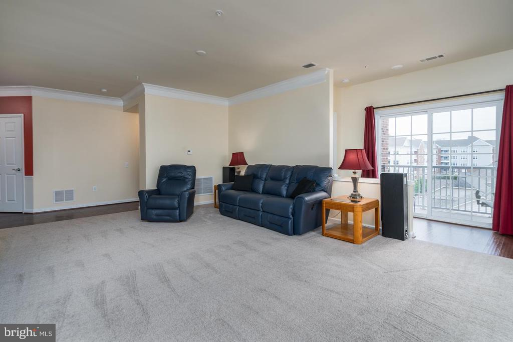 Living Room and Sliding Glass Door to Balcony - 20570 HOPE SPRING TER #401, ASHBURN
