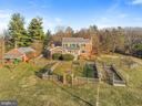 Aerial view of all brick home, 3 bay garage. - 18217 CANBY RD, LEESBURG