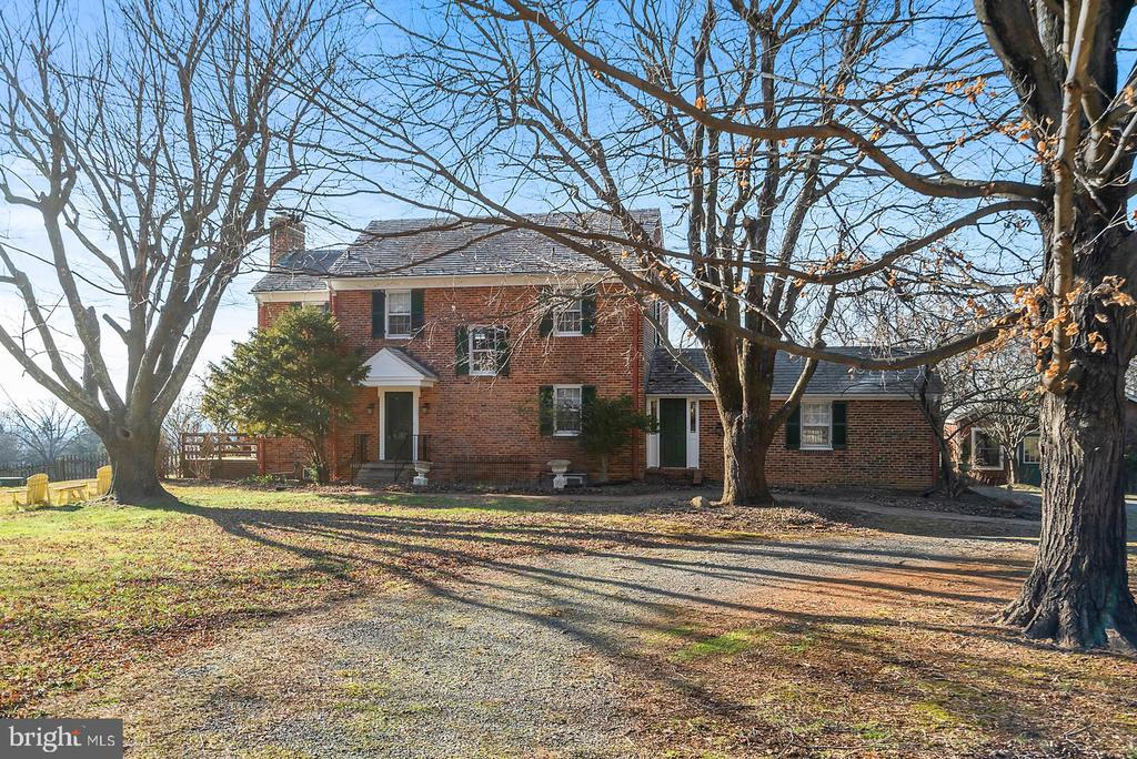 Front formal approach by tree lined drive. - 18217 CANBY RD, LEESBURG