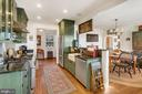 Dreamy kitchen overlooks breakfast bar to dining. - 18217 CANBY RD, LEESBURG