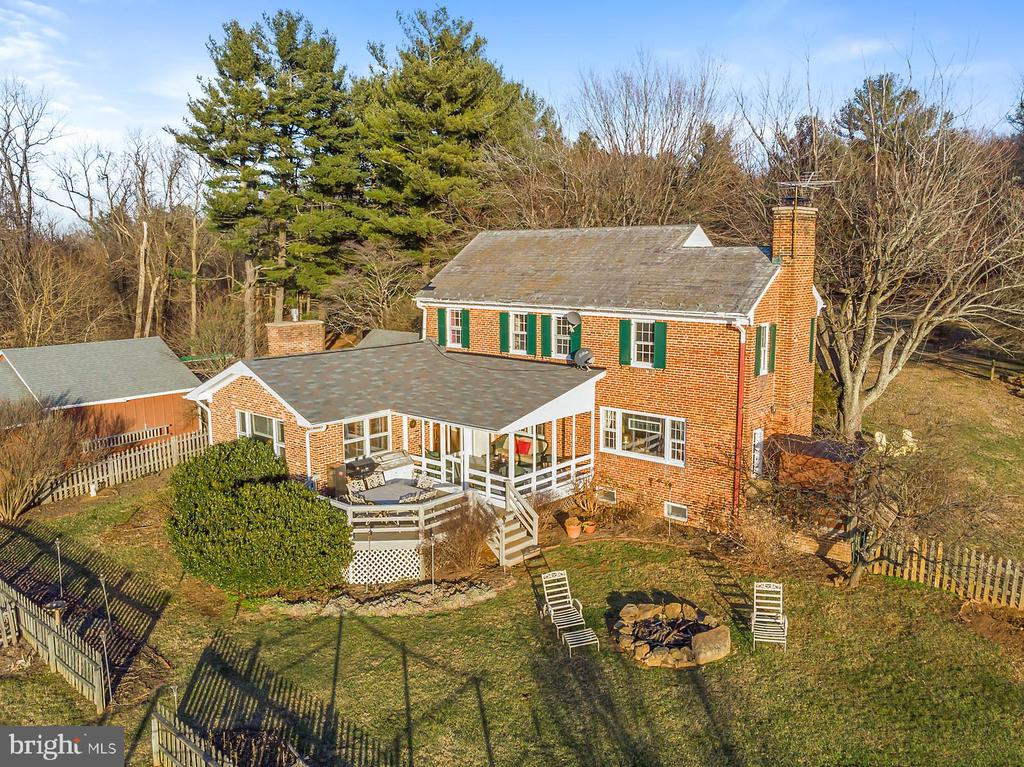 Aerial view of rear of Farmette home. - 18217 CANBY RD, LEESBURG
