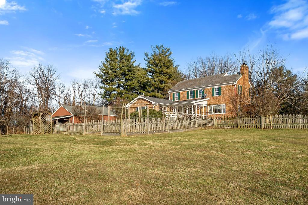 A short walk from the barn to the garden & home. - 18217 CANBY RD, LEESBURG