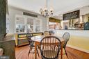 Dining overlooking screened porch/breakfast bar. - 18217 CANBY RD, LEESBURG