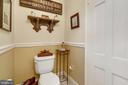 Chair rail in vintage style powder room on main. - 18217 CANBY RD, LEESBURG