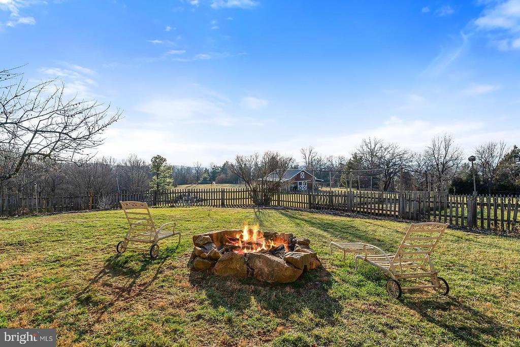 Entertain or relax near the fire all year round. - 18217 CANBY RD, LEESBURG