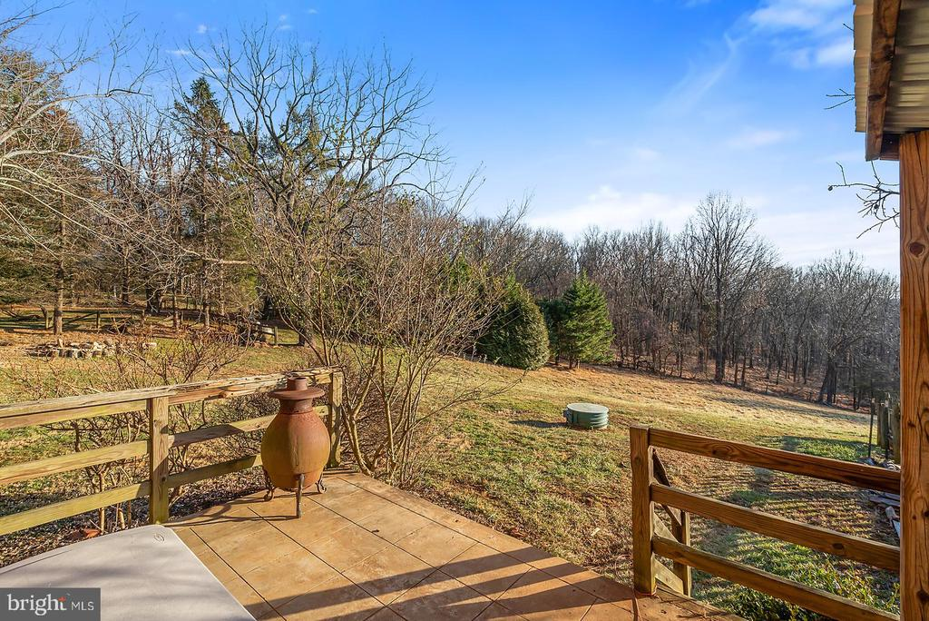 Views from every angle of brick farm style home. - 18217 CANBY RD, LEESBURG