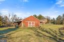 View from the lower fields in back to the barn. - 18217 CANBY RD, LEESBURG