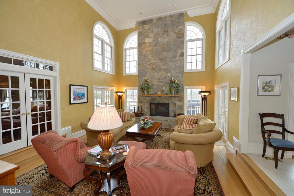 Family room with 2 story stone fireplace - 37120 DEVON WICK LN, PURCELLVILLE