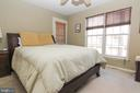 Master bedroom with door leading out to patio - 9812 SPANISH OAK WAY #118, BOWIE