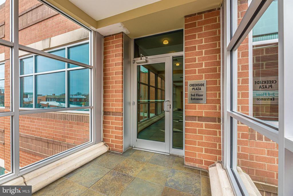 Enclosed skywalk leads you from parking garage. - 50 CITIZENS #504, FREDERICK