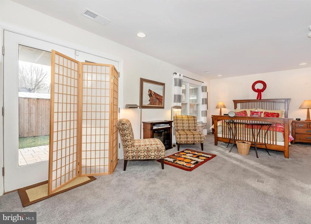 Lower level carpeted space with access to patio. - 43 MAXWELL SQ, FREDERICK