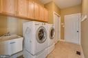 Main level laundry room with garage access - 20190 KIAWAH ISLAND DR, ASHBURN