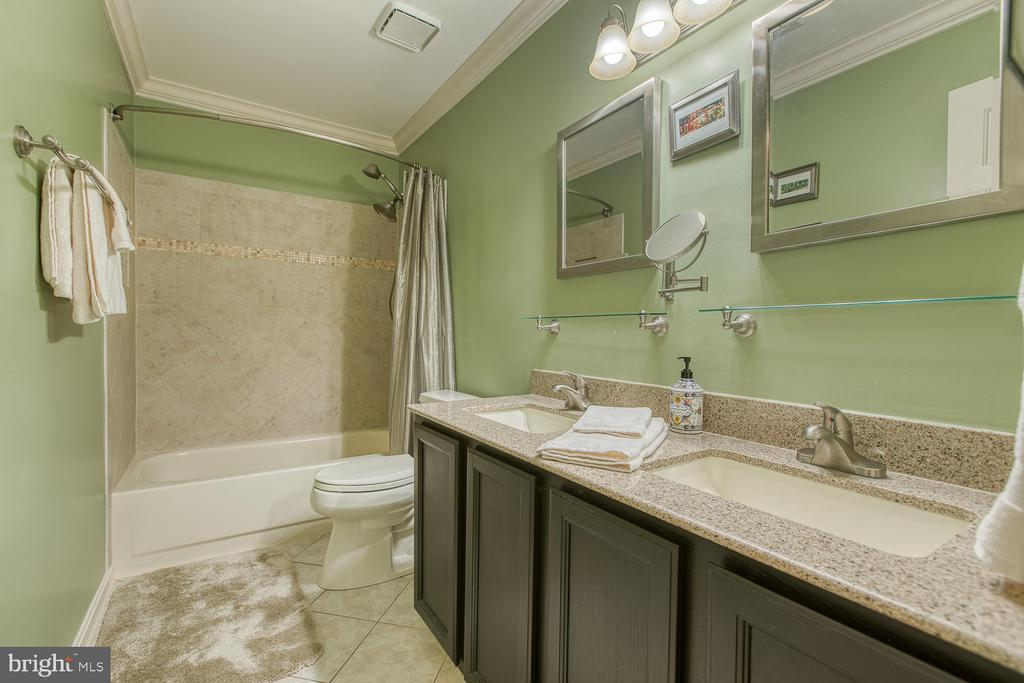 Hall bath with quartz counter and ceramic tile - 131 EUSTACE RD, STAFFORD